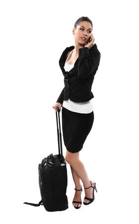 travelling business girl with luggage and smartphone photo