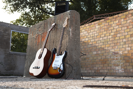 musical instruments isolated on the wall Stock Photo