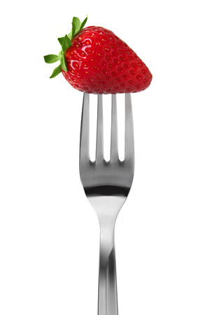 strawberry on the fork Stock Photo