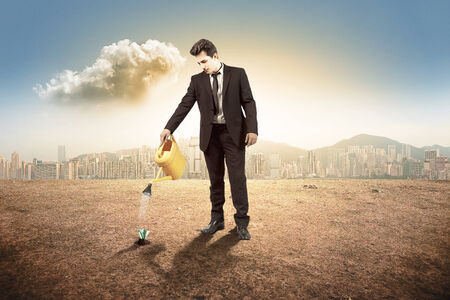 business man growing up single money sprout Stock Photo