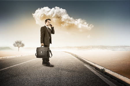 business man in the middle of the road Stock Photo