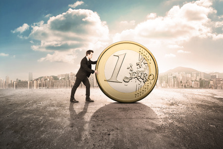 business man pushing the euro coin