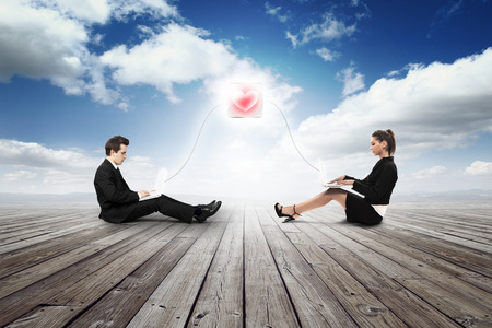 business girl and man are falling in love with laptop