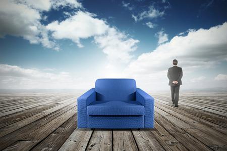 abandoning: business man abandoning his chair Stock Photo