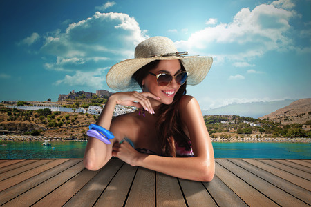 girl with sunglasse and straw hat at the sea Stock Photo