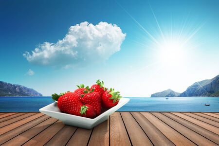 strawberries on the harbor Stock Photo