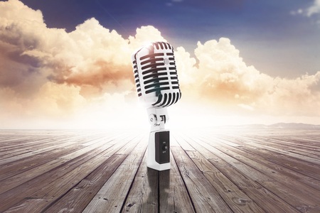 vintage microphone on  wooden surface