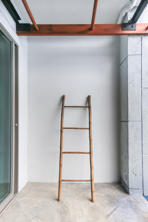 spare ladder for help getting out of swimming pool photo