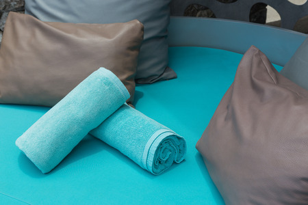 recliner: towels and pillow on recliner chair at poolside
