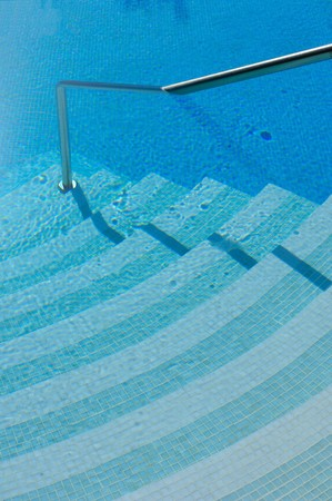 Stair into a luxury swimming pool photo