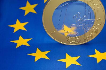 financial diversification: One-Euro-coin on a european flag Stock Photo