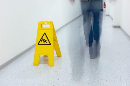 falling down: Warning sign for slippery floor
