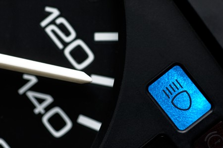 mountings: Speed indicator and beam control lamp of a car