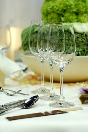 Dining table with wine glasses and flower decoration photo