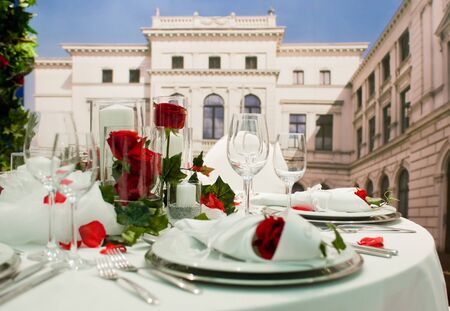 feast table: Covered banquet with red roses decoration