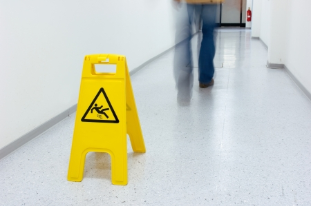 smoothness: Warning sign slippery floor Stock Photo
