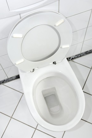 incontinence: White toilette with open lid Stock Photo