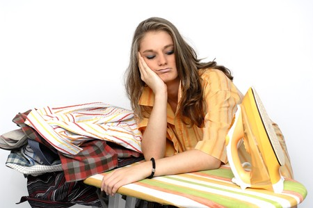 listless: Frustrated young woman at a ironing board Stock Photo