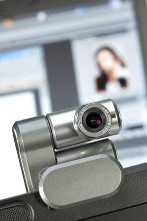 Webcam with PC-screen in the background Фото со стока