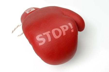 delaying: Red boxing glove with the word Stop