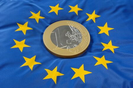 exchange rate: Euro coin on a euro flag
