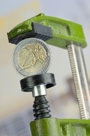 A Two-Euro-coin in a clamp photo