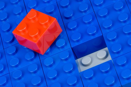 amend: Red building block in a field of blue ones