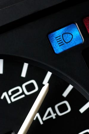 kph: Speedometer an blue beam control light of a car