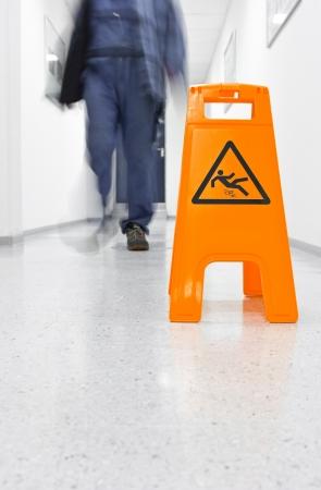 Warning sign slippery floor Stock Photo