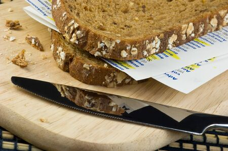 Slices of bread with sides of an schoolbook between them Stock Photo - 7670461