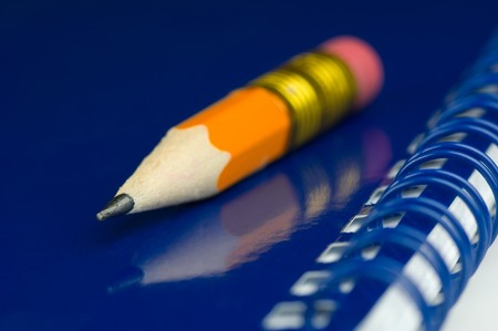 quoted: Short pencil on a blue notepad Stock Photo
