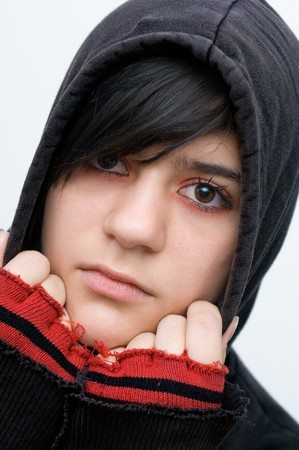 pubescent: Young woman with black hooded jacket and red finfer stalls