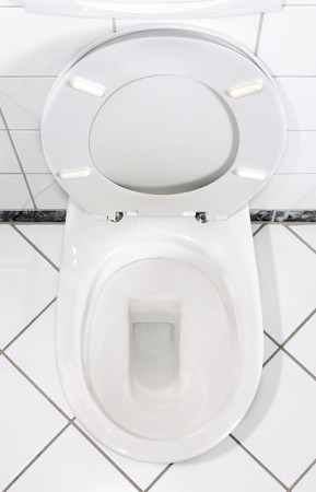 White toilet bowl with open lid Stock Photo - 7709060