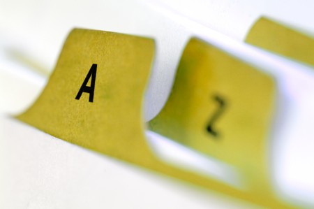 classifying: Yellow file cards A an Z in a close up shot