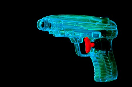 trigger: Blue water pistol with a red trigger on black background