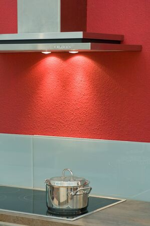 kitchenette: Modern fitted kitchen with red wall Stock Photo