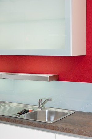 Modern fitted kitchen with red wall photo