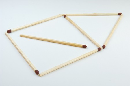 statics: Simple house of matches on white ground