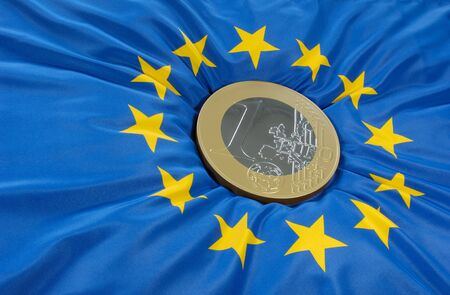 diversification: Euro coin on a european flag Stock Photo