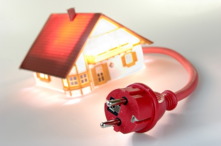 plugs: Model house with red plug, short-circuit