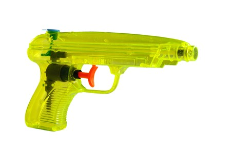 tetik: Yellow water pistol with red trigger on white ground Stok Fotoğraf