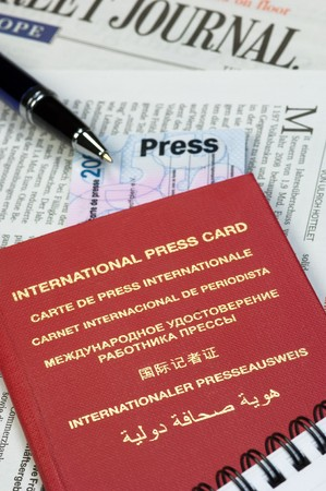 legitimize: International press card, pen and notepad on a newspaper