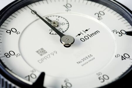 White face of a dial gauge, manual measuring instrument