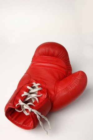 alarming: Single red boxing glove on white ground