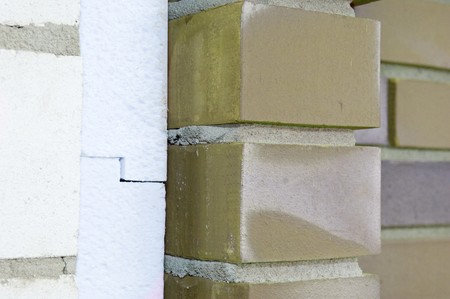Thermal insulation of a house wall on a construction site photo