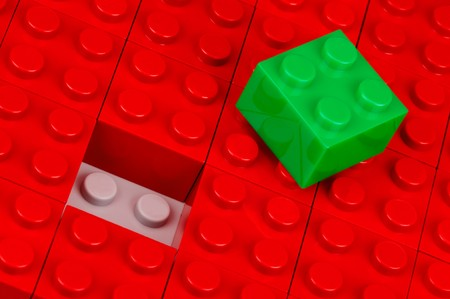 amend: Green building block in a field of red one