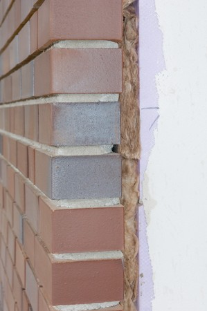 rock wool: Thermal insulation of a house wall on a construction site