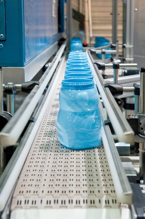 Mass production of plastic containers photo