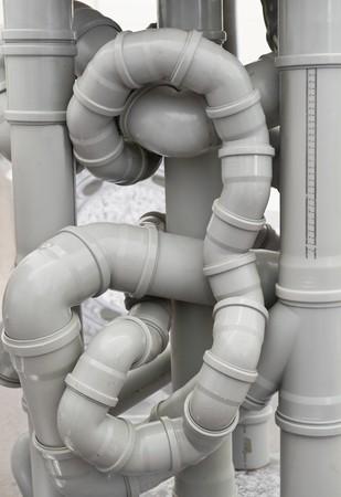 drenaggio: Caos di tubi di scarico  Archivio Fotografico