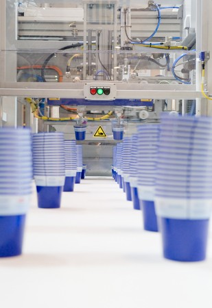 Mass production of plastic cups photo